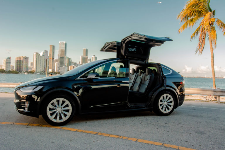 Black Tesla Model X with doors open @ Luxury Travel Transportation